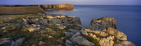 sunlit rocks at st govan's head